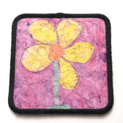 square fabric patch with black border around artwork and adhesive back